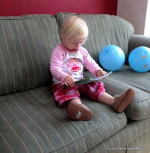 Matilda reading on sofa