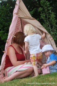 Alex, Henry and Matilda in teepee