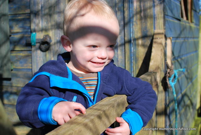 Henry smiling outside play house