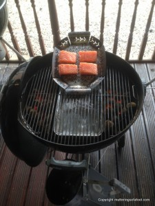 Hot smoking salmon on BBQ