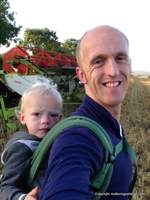 Me and Henry checking out the combine