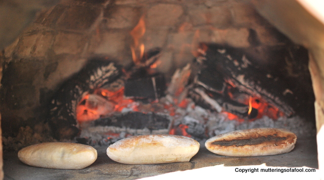 Pita breads cooking