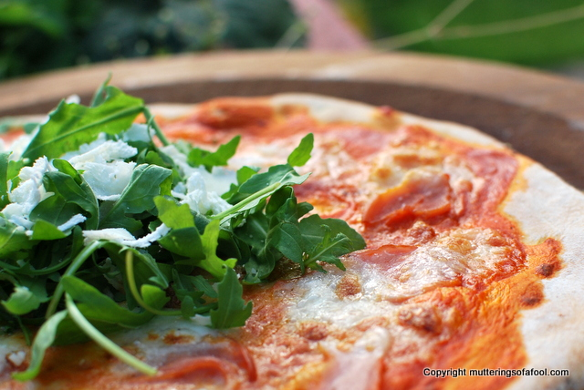 The perfect ham parmesan and rocket pizza