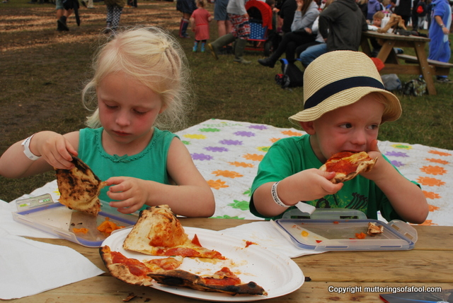 Eating pizza at CarFest south