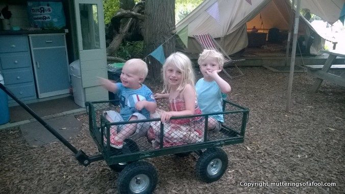 3 kids in trailer at bell tent